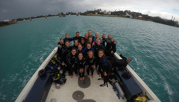 <p> 	A fall semester class poses for a photo after a dive.</p>