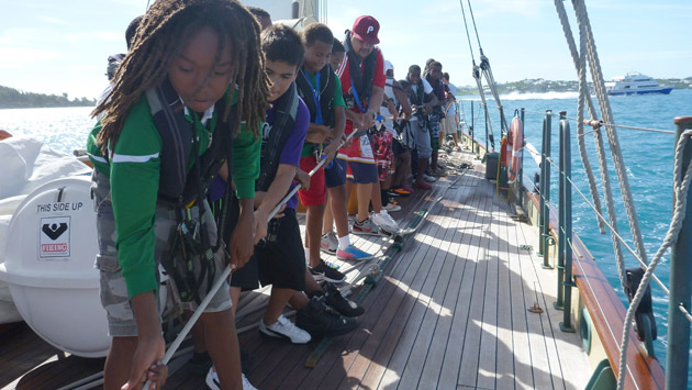 <p> 	Increasing team work and collaboration skills as <em>Spirit of Bermuda</em> trainees haul lines.</p>