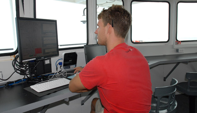 <p> 	BIOS intern reviews CTD data on board the R/V <em>Atlantic Explorer</em>.</p>