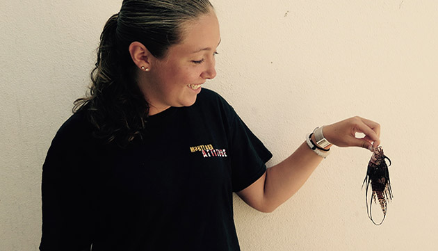<p> Marine Science Intern holding up the smallest invasive lionfish caught this summer at BIOS.</p>
