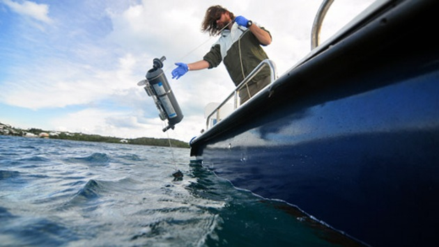 <p> 	Research Specialist Tim Noyes deploying equipment to monitor water quality.</p>