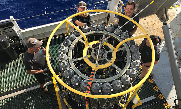 <p> 	Rod Johnson (BATS Co-PI), Emily Davey (Research Technician), Dom Smith (Research Technician) and Claire Medley (Research Technician) sample the CTD for dissolved O2 and CO2 aboard the R/V Atlantic Explorer during a routine Bermuda Atlantic Time-series Study (BATS) cruise.</p>