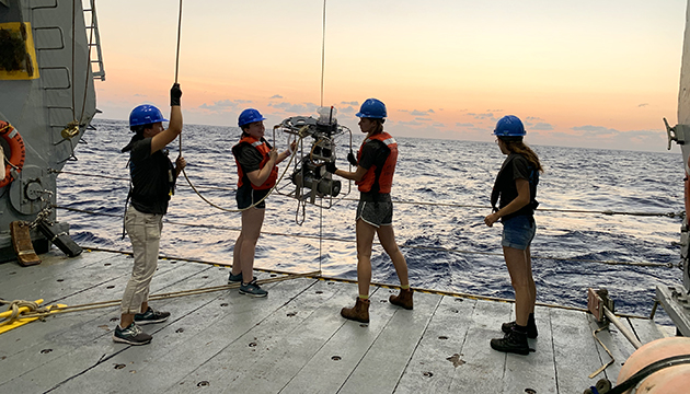<p> 	Ella Cedarhold (Marine Technician), Claire Medley (Research Technician), Emily Davey (Research Technician), and Lydia Sgouros (Marine Techician) deploy an in-situ pump off the stern of the R/V Atlantic Explorer for proteomics sampling during a recent Bermuda Atlantic Time-series Study (BATS) cruise.</p>