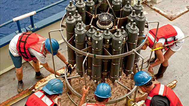 <p> 	Scientists fasten the CTD to the deck after a successful recovery.</p>