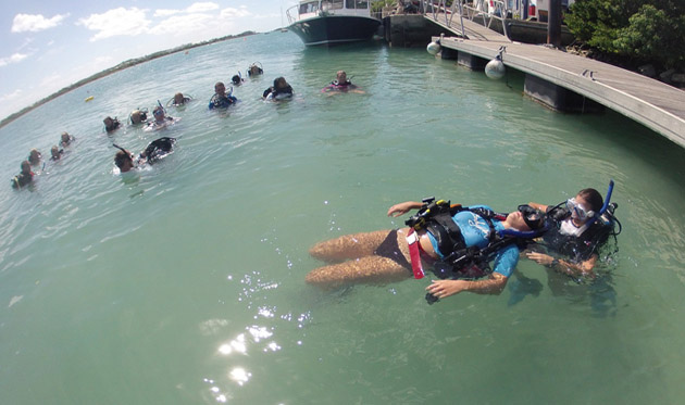 <p> 	Fall student, Ashley Powell, practices her rescue diver skills on an &ldquo;unconscious&rdquo; Sarah Miller.&nbsp;</p>